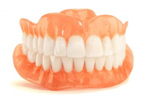 a full set of dentures in front of a white background